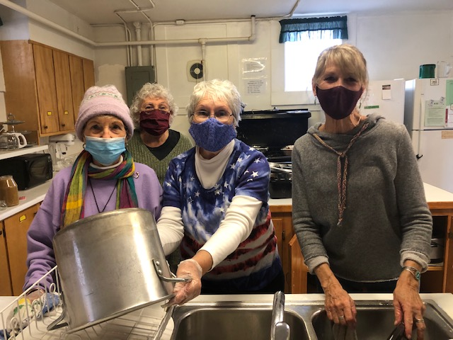 Collbran UCC Volunteers serve a Thanksgiving 'take out' meal. image